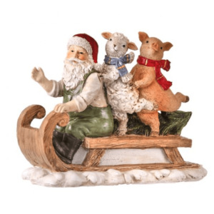 Santa on sled with pig and sheep