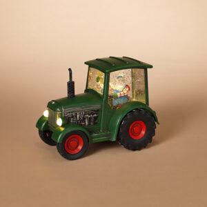 Santa in green tractor water globe