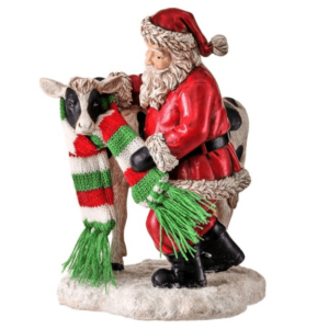 Santa putting scarf on cow figure