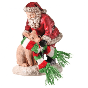 Santa putting scarf on pig figure