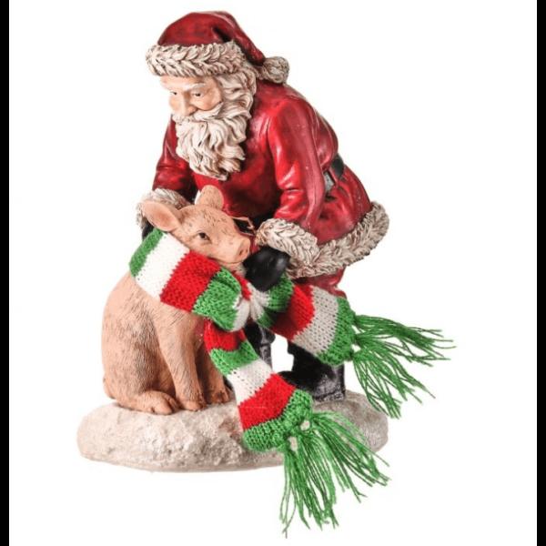 Santa putting scarf on pig figure