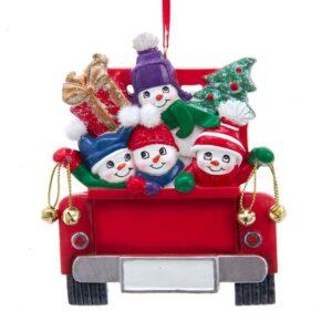 four snowmen in back of truck ornament
