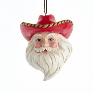 Santa wearing a red cowboy hat with a gold-laced brim.